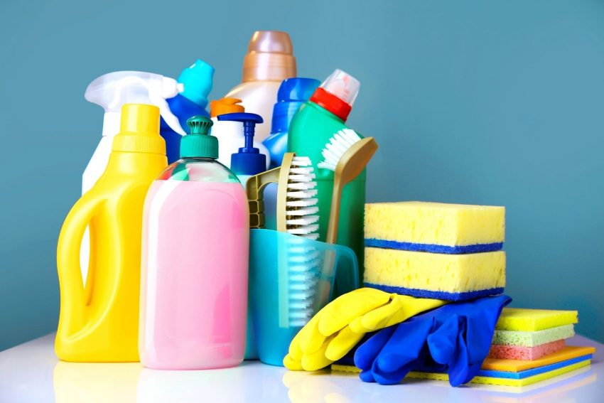 different types of bleach and cleaning products on a table